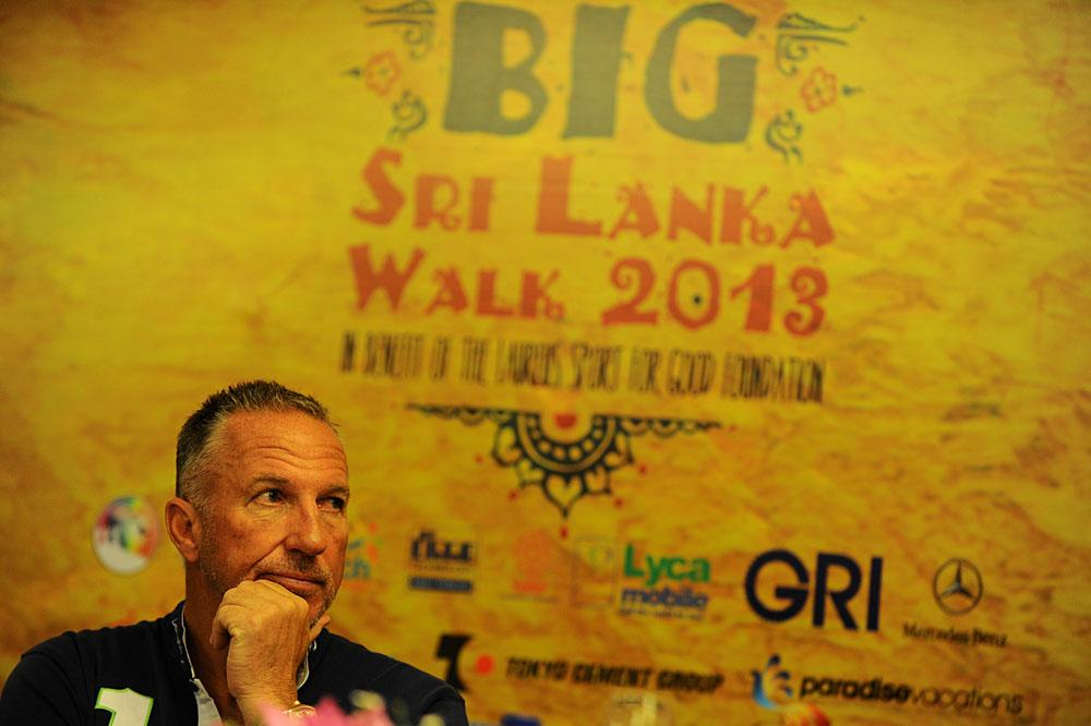 Former England cricketer Ian Botham looks on during a press conference in Colombo on August 15, 2013, as he announced he would walk hundreds of miles in the humid island of Sri Lanka in a bid to raise money for charity.  Botham said he will walk nearly 600 kilometres (375 miles) from the former Sri Lankan war zone to the southern coastal town of Hambantota, the home constituency of President Mahinda Rajapakse in November 2013.   AFP PHOTO/Ishara S.KODIKARA        (Photo credit should read Ishara S.KODIKARA/AFP/Getty Images)