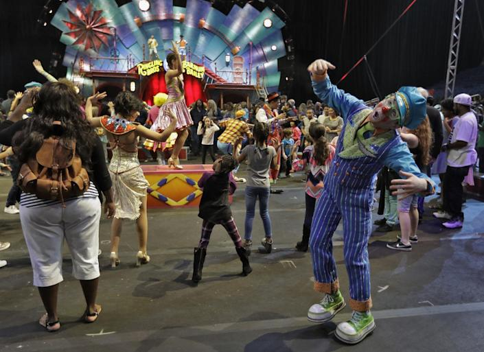 """Ringling Bros. and Barnum & Bailey clowns dance with fans during a pre show for fans Saturday, Jan. 14, 2017, in Orlando, Fla. The Ringling Bros. and Barnum & Bailey Circus will end the """"The Greatest Show on Earth"""" in May, following a 146-year run of performances. Kenneth Feld, the chairman and CEO of Feld Entertainment, which owns the circus, told The Associated Press, declining attendance combined with high operating costs are among the reasons for closing. (AP Photo/Chris O'Meara)"""