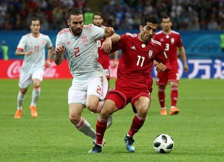 Soccer Football - World Cup - Group B - Iran vs Spain - Kazan Arena, Kazan, Russia - June 20, 2018 Spain's Dani Carvajal in action with Iran's Vahid Amiri REUTERS/Sergio Perez