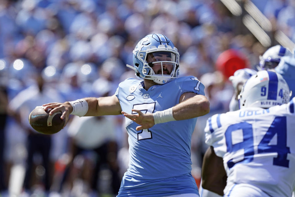 North Carolina quarterback Sam Howell (7) passes against Duke during the first half of an NCAA college football game in Chapel Hill, N.C., Saturday, Oct. 2, 2021. (AP Photo/Gerry Broome)