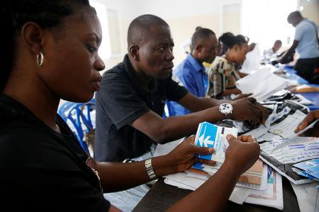 Officials from Congo's Independent National Electoral Commission (CENI) count presidential elections ballots at tallying centre in Kinshasa, Democratic Republic of Congo, January 4, 2019. REUTERS/Baz Ratner