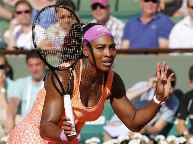 Serena Williams of the U.S. reacst during her women's semi-final match against Timea Bacsinszky of Switzerland at the French Open tennis tournament at the Roland Garros stadium in Paris, France, June 4, 2015. REUTERS/Jean-Paul Pelissier