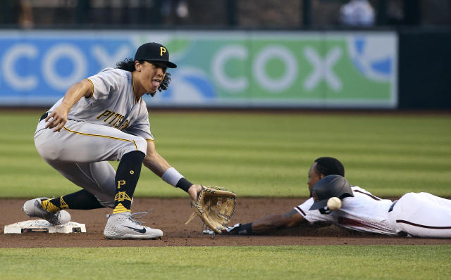 Pittsburgh Pirates shortstop Cole Tucker, left, waits for a late throw as Arizona Diamondbacks' Jarrod Dyson, right, steals second base during the first inning of a baseball game Monday, May 13, 2019, in Phoenix. (AP Photo/Ross D. Franklin)
