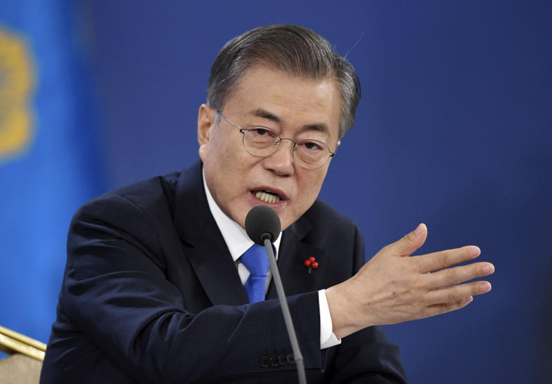 South Korea's President Moon Jae-in holds his New Year press conference at the presidential Blue House in Seoul Thursday, Jan. 10, 2019. Moon urged North Korea to take firmer disarmament measures and the U.S. to reward them, suggesting Thursday he'll push for sanction exemptions to restart dormant economic cooperation projects with the North. (Jung Yeon-je/Pool Photo via AP)