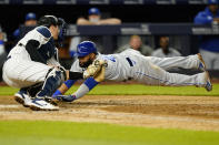Kansas City Royals Carlos Santana (41) dives ahead of the tag by New York Yankees catcher Kyle Higashioka during the eighth inning of a baseball game, Tuesday, June 22, 2021, at Yankee Stadium in New York. (AP Photo/Kathy Willens)