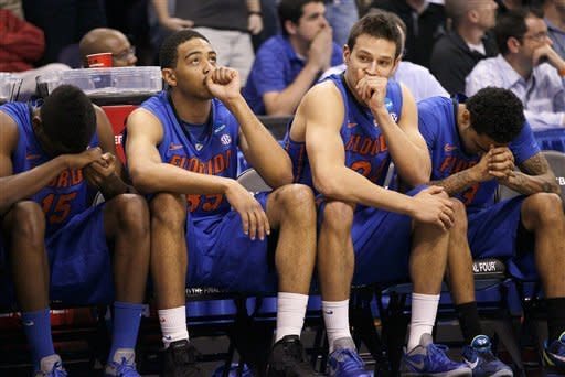 Florida react on the bench during the closing moments of the second half of an NCAA tournament West Regional final college basketball game against Louisville, Saturday, March 24, 2012, in Phoenix. Florida lost to Louisville 72-68. (AP Photo/Matt York)