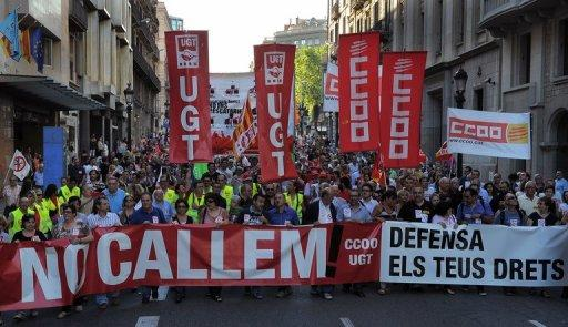 People march in a demonstration organized by unions on June 20, in Barcelona, against government welfare cuts. Troubled eurozone nations agreed to act quickly to save Spain's banks, and to send international creditors to Greece for an update from the new government