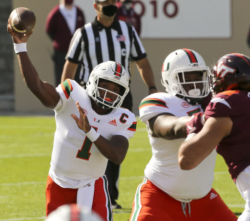 Miami quarterback D'Eriq King passes during the first half of an NCAA college football game Saturday, Nov. 14, 2020, in Blacksburg, Va. (Matt Gentry/The Roanoke Times via AP, Pool)