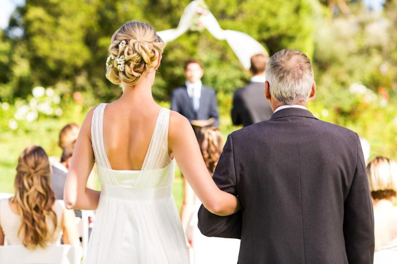 Anyone can walk the bride down the aisle. Photo: Getty Images