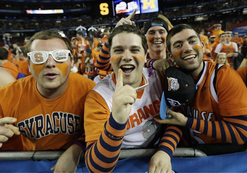 Syracuse fans cheers before the first half of the NCAA Final Four tournament college basketball semifinal game against Michigan, Saturday, April 6, 2013, in Atlanta. (AP Photo/David J. Phillip)