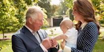 <p>The Duchess of Cambridge holds Prince Louis as Prince Charles plays with his new grandson in the Clarence House Gardens. </p>