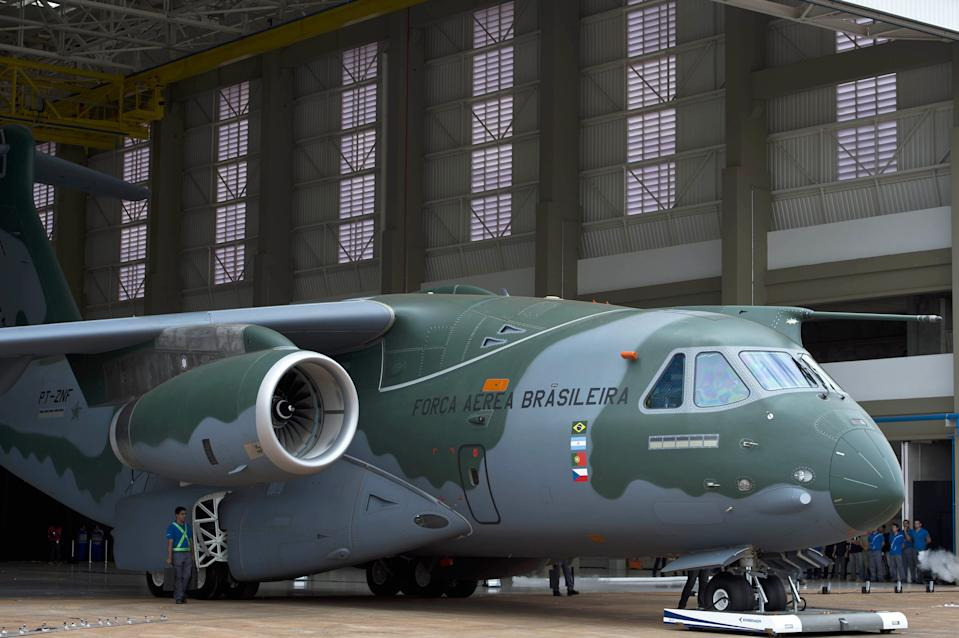 The new Embraer KC-390 aircraft being built is presented at their production facilities in Gaviao Peixoto, some 310 km from Sao Paulo, Brazil on October 21, 2014. The Embraer KC-390 tanker-transport aircraft has entered into the production phase of its development schedule that includes the series manufacture of 28 aircraft for the Brazilian Air Force (FAB). AFP PHOTO / NELSON ALMEIDA (Photo credit should read NELSON ALMEIDA/AFP via Getty Images)
