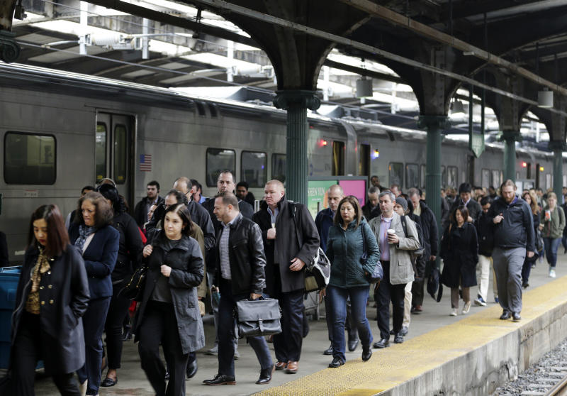 Commuters make their way through Hoboken Terminal in Hoboken, N.J., Wednesday, April 5, 2017. Train passengers are facing delays while repairs continue days after a commuter train derailment inside New York City's Penn Station. (AP Photo/Seth Wenig)