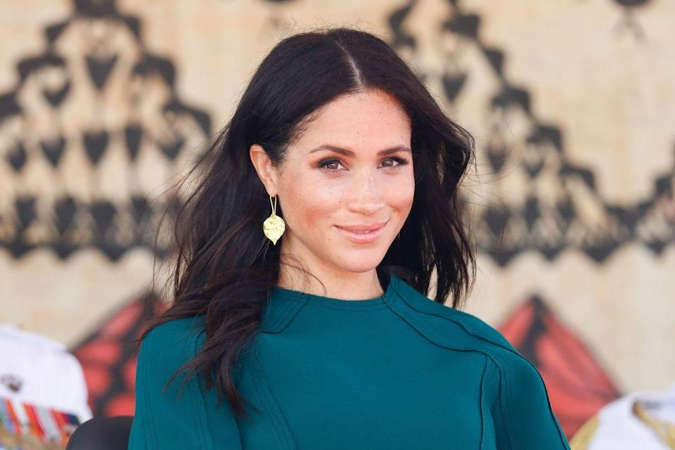 """<p>Meghan's trainer McNamee told <a href=""""https://www.womenshealthmag.com/fitness/a19745816/meghan-markle-workout/"""" rel=""""nofollow noopener"""" target=""""_blank"""" data-ylk=""""slk:WomensHealthMag.com"""" class=""""link rapid-noclick-resp"""">WomensHealthMag.com</a> in 2018 that she particularly loves doing lower-body exercises using a <a href=""""https://www.womenshealthmag.com/fitness/a19953228/total-body-resistance-band-workout/"""" rel=""""nofollow noopener"""" target=""""_blank"""" data-ylk=""""slk:mini band"""" class=""""link rapid-noclick-resp"""">mini band</a>—which can conveniently be used just about anywhere.</p>"""