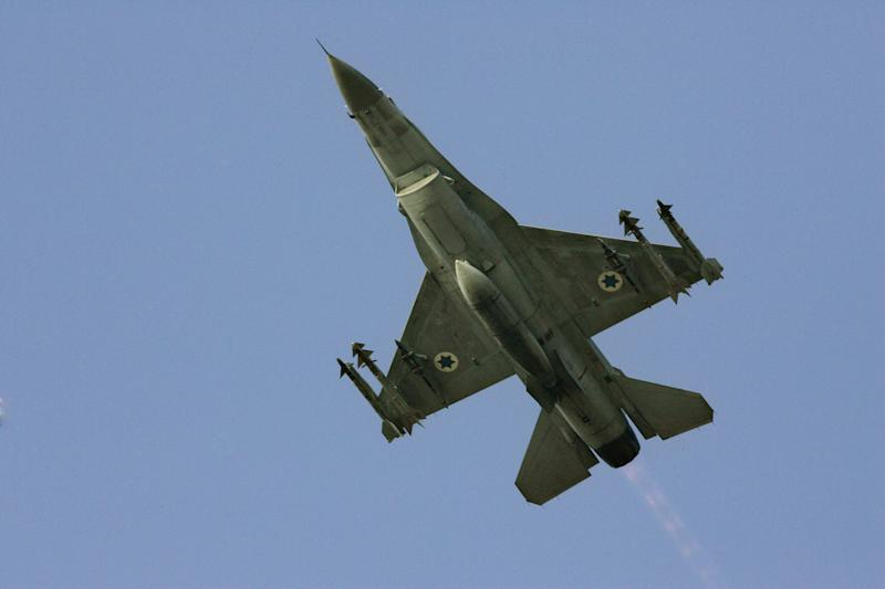 FILE - In this Sunday, July 16, 2006 file photo an Israeli F-16 warplane takes off to a mission in Lebanon from an air force base in northern Israel. A rising chorus of Israeli voices is again raising the possibility of carrying out a military strike on Iran's nuclear facilities in what appears to be an attempt to draw renewed attention to Tehran's atomic program - and Israel's unhappiness with international negotiations with the Iranians. (AP Photo/Ariel Schalit, File)