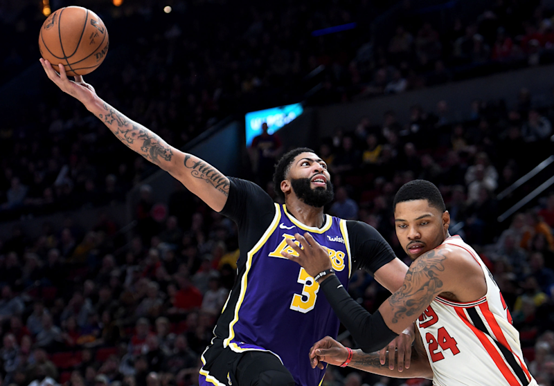 Anthony Davis #3 of the Los Angeles Lakers loses control of the ball as he goes up for a shot over Kent Bazemore.