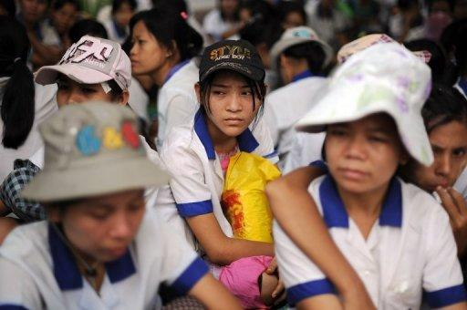 Myanmar labourers from a garment factory are seen sitting in protest outside their factory after staging a walkout, at the Hlaing Thar Yar industrial zone in Yangon, on May 16. Silenced for years under junta rule, Myanmar's workers are finding their voice to demand better pay -- with teething problems expected as staff and employers come to terms with unprecedented labour reform