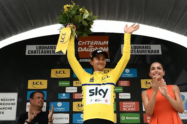 Poland's Michal Kwiatkowski on the podium after Great Britain's Sky cycling team won the team time trial stage of the 70th edition of the Criterium du Dauphine cycling race (AFP Photo/Philippe LOPEZ)