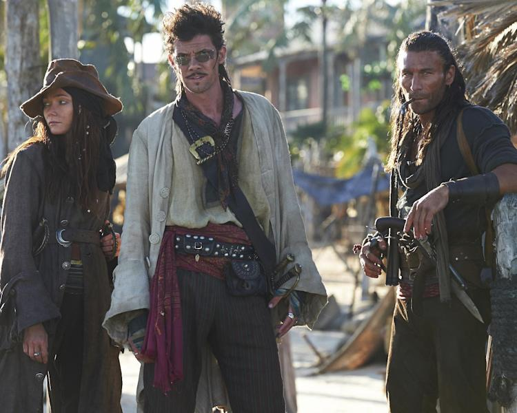 """This publicity photo provided by Starz Entertainment, LLC shows, from left, Clara Paget as Anne Bonny, Zach McGowan as Captain Charles Vane, and Toby Schmidt as Jack Rackham in a scene from """"Black Sails."""" (AP Photo/Copyright Starz Entertainment, LLC, Frank W Ockenfels 3)"""