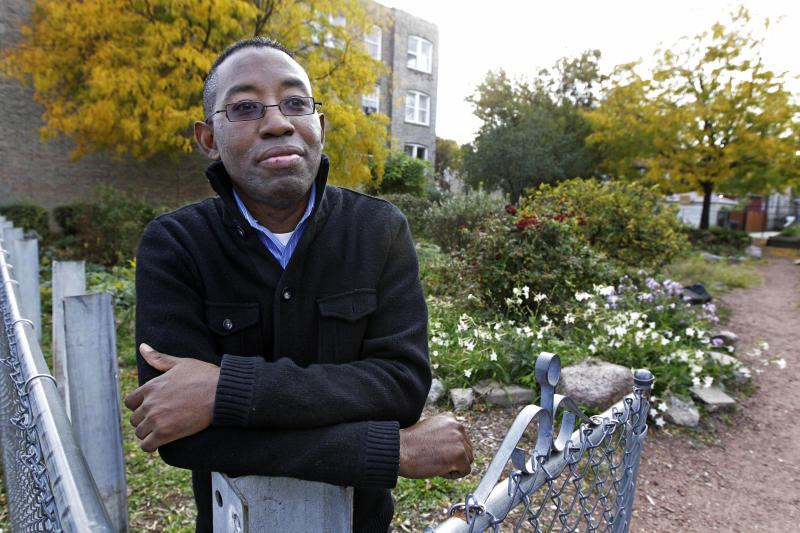 In this Oct. 11, 2012 photo, community activist Elce Redmond poses for photos in a community garden on Chicago's West Side. In the coming days, the city is bound to reach another grim milestone when the number of homicides for 2012 surpasses 433, the total for all of last year. Redmond has seen residents cleaning up vacant lots, planting community gardens and boarding up abandoned buildings to prevent gang members and drug dealers from getting inside. (AP Photo/M. Spencer Green)