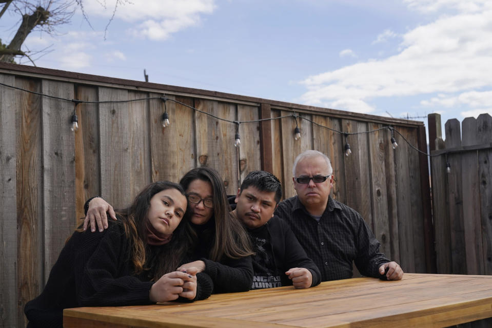 Cassandra Quinto-Collins, the mother of Angelo Quinto, second from left, sits with daughter Bella Collins, from left, son Andrei Quinto and husband Robert Collins during an interview in Antioch, Calif., Tuesday, March 16, 2021. Angelo Quinto died three days after being restrained on Dec. 23, 2020, in police custody while having a mental health crisis. Lawmakers in several states are proposing legislation that would require more training for police in how to interact with someone in a mental crisis following some high-profile deaths. (AP Photo/Jeff Chiu)