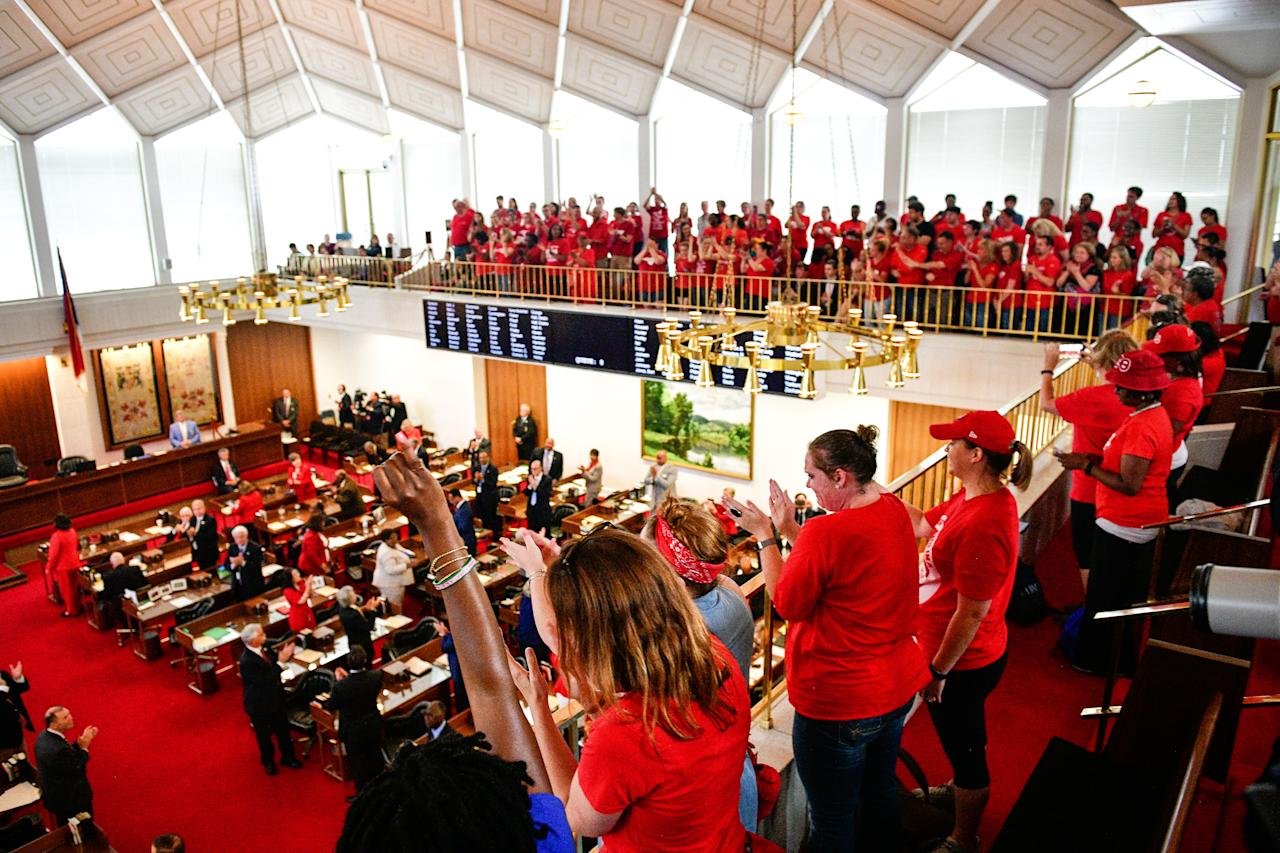 <p>Teachers and supporters stand during a 'March For Students And Rally For Respect' protest at the North Carolina State Assembly, on the first day of the state's legislative session, in Raleigh, N.C., on Wednesday, May 16, 2018. (Photo: Charles Mostoller/Bloomberg via Getty Images) </p>