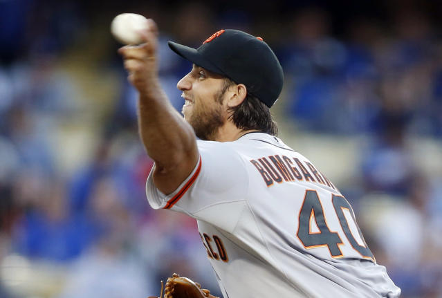 San Francisco Giants starting pitcher Madison Bumgarner delivers against the Los Angeles Dodgers during the first inning of a baseball game, Friday, May 9, 2014, in Los Angeles. (AP Photo/Danny Moloshok)
