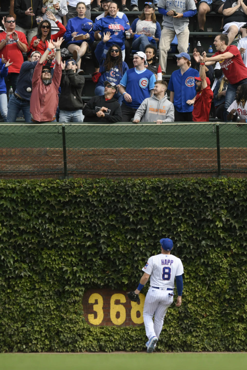 Chicago Cubs outfielder Ian Happ watches St. Louis Cardinals' Harrison Bader's solo home run during the second inning of a baseball game Saturday, Sept. 25, 2021. (AP Photo/Paul Beaty)