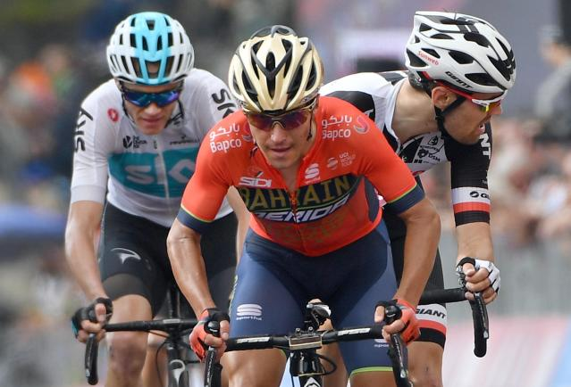 FILE - In this Thursday, May 24, 2018 file photo, Italy's Domenico Pozzovivo leads Dutch rider Tom Dumoulin, right, and Britain's Chris Froome during the 18th stage of the Giro d'Italia cycling race, from Abbiategrasso to Prato Nevoso, Italy. Pozzovivo will undergo surgery and miss the Spanish Vuelta after being injured in a collision with a car while training. The 36-year-old Pozzovivo fractured bones in his leg and arm in the crash in Cosenza in southern Italy on Monday, Aug. 12, 2019 and was taken by ambulance to Annunziata Hospital. (Daniel Dal Zennaro/ANSA via AP, File)