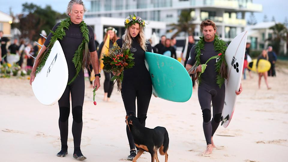 Alex Pullin's father and girlfriend Ellidy Vlug, pictured here paying their respects at Palm Beach.