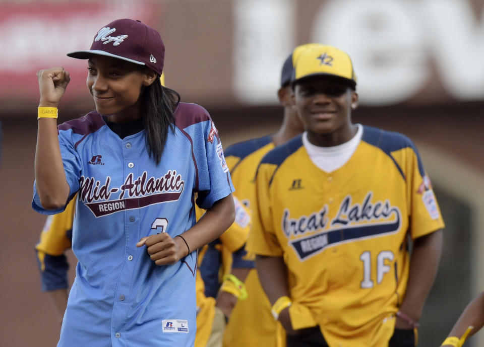 Oct 25, 2014; San Francisco, CA, USA; Little League baseball player Mo'ne Davis reacts after throwing out a ceremonial first pitch before game four of the 2014 World Series between the San Francisco Giants and the Kansas City Royals at AT&T Park. Mandatory Credit: Christopher Hanewinckel-USA TODAY Sports