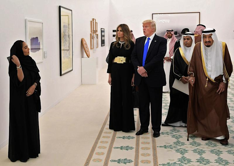 Saudi Arabia's King Salman bin Abdulaziz al-Saud (right), President Donald Trump and Melania Trump look at Saudi modern art at the Saudi Royal Court in Riyadh.