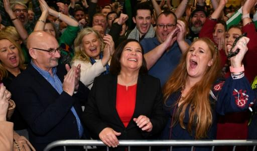 Sinn Fein leader Mary Lou McDonald (C) celebrates with supporters after she was returned to her central Dublin seat