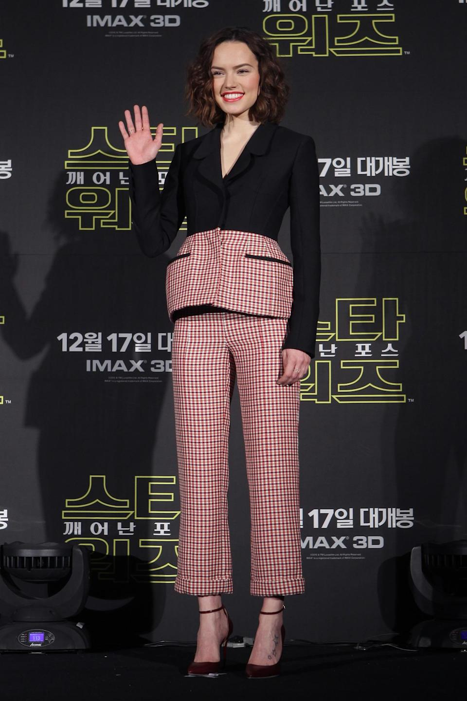 <p>While Nyong'o was in Mexico City, the rest of the cast was promoting their new film in Seoul. Ridley wore a sophisticated suit from Dior's resort 2016 collection, with burgundy pumps and bright lipstick. </p><p><i>Photo: Getty Images</i></p>