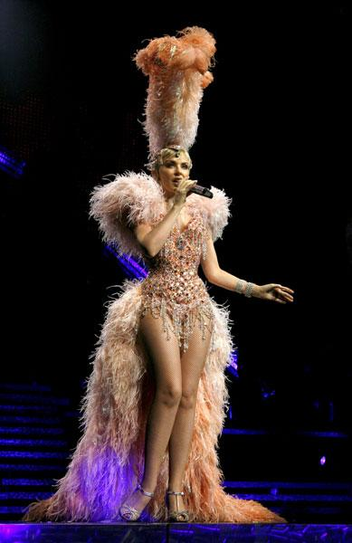 <b>Kylie on her Showgirl tour, 2006</b><br><br>Resuming her tour after overcoming breast cancer, Kylie proved to the world that she is the No1 showgirl in this cabaret style costume dress with nude fishnets.
