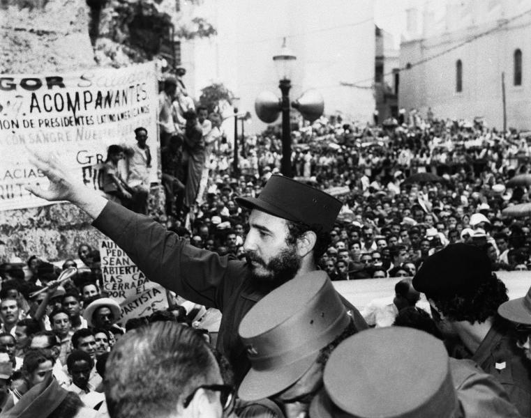 FILE-In this March 22, 1959, file photo, Fidel Castro, Cuba's Prime Minister, salutes the crowd at labor rally supporting him in Havana. Causes across the political spectrum have long used distinctive salutes to identify themselves. When Anders Behring Breivik, the far-right suspect in the massacre of 77 people in Norway, pulled his right hand to his chest and then thrust his arm out with a clenched fist after an Oslo courtroom guard removed his handcuffs on Monday, April 16, 2012; it was hardly the first time such a salute has been flashed. (AP Photo/File)