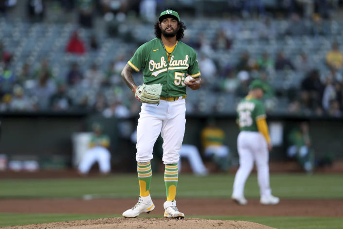 Oakland Athletics' Sean Manaea stands on the mound after giving up an RBI-single to San Diego Padres' Jake Cronenworth during the first second inning of a baseball game in Oakland, Calif., Tuesday, Aug. 3, 2021. (AP Photo/Jed Jacobsohn)