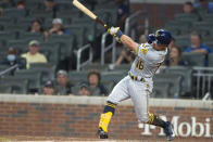 Milwaukee Brewers' Kolten Wong hit a single during the ninth inning of the team's baseball game against the Atlanta Braves. Saturday, July 31, 2021, in Atlanta. (AP Photo/Hakim Wright Sr.)