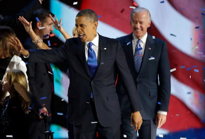 President Barack Obama waves to his supporters after his speech at his election night party Wednesday, Nov. 7, 2012, in Chicago. President Obama defeated Republican challenger former Massachusetts Gov. Mitt Romney. At right is Vice President Joe Biden. (AP Photo/Pablo Martinez Monsivais)