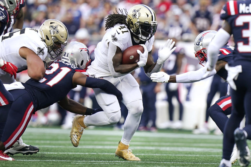 New Orleans Saints running back Alvin Kamara (41) runs for a gain during the first half of an NFL football game against the New England Patriots, Sunday, Sept. 26, 2021, in Foxborough, Mass. (AP Photo/Steven Senne)