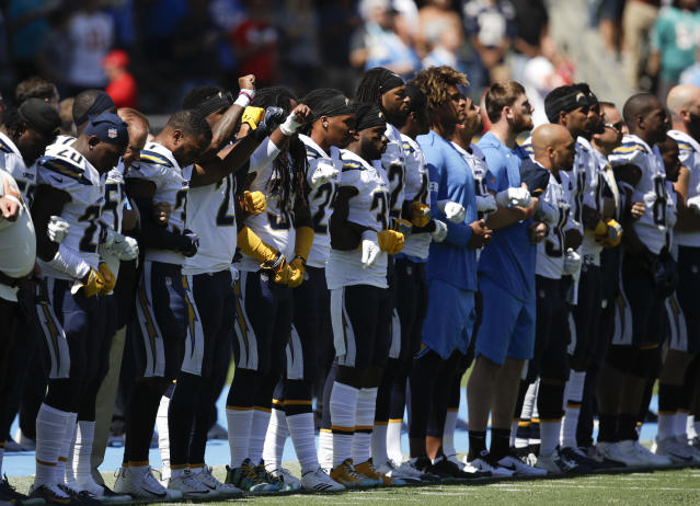 <p>Members of the Los Angeles Chargers link arms during the national anthem before an NFL football game against the Kansas City Chiefs, Sunday, Sept. 24, 2017, in Carson, Calif. (AP Photo/Jae C. Hong) </p>