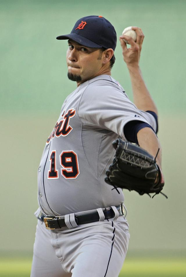 Detroit Tigers starting pitcher Anibal Sanchez throws during the first inning of a baseball game against the Kansas City Royals on Friday, July 11, 2014, in Kansas City, Mo. (AP Photo/Charlie Riedel)