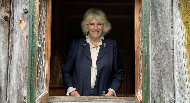 Undated handout photo issued by Clarence House of the Duchess of Cornwall at Birkhall in Scotland, inside a Wendy House originally built on the estate in 1935 for the then Princess Elizabeth and Princess Margaret.