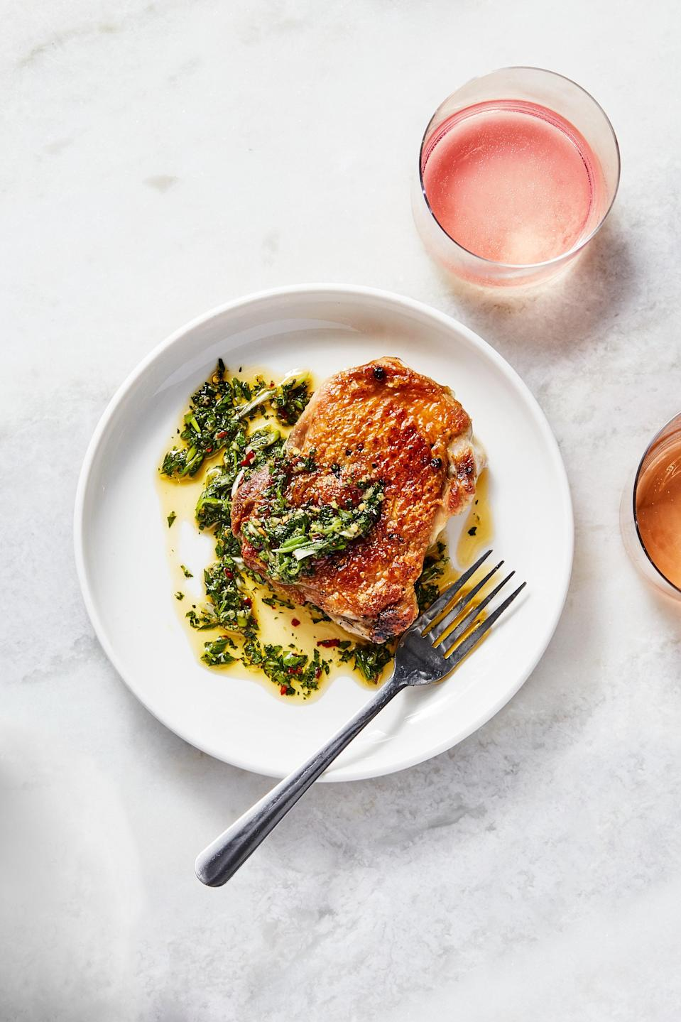 """A brick's an unusual kitchen tool, but in this recipe it fulfills a very important task: Cooking boneless (but skin on!) chicken thighs underneath it renders the skin as crisp as can be, while the interior stays super-juicy. <a href=""""https://www.epicurious.com/recipes/food/views/chicken-under-a-brick-in-a-hurry?mbid=synd_yahoo_rss"""" rel=""""nofollow noopener"""" target=""""_blank"""" data-ylk=""""slk:See recipe."""" class=""""link rapid-noclick-resp"""">See recipe.</a>"""