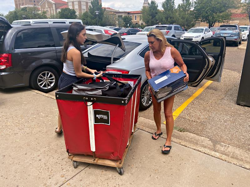 Kaitlyn Abercia is seen moving into her student residence at Gates Hall on the campus of Texas Tech University in Lubbock, Texas, U.S. on August 14, 2020. REUTERS/Brad Brooks