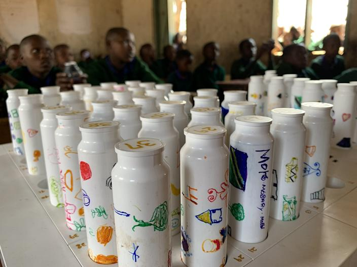Each student's solar battery is numbered at this Tanzanian grade school.