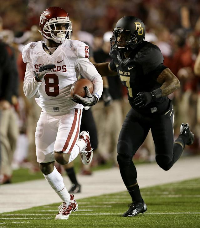 Oklahoma wide receiver Jalen Saunders (8) is chased down by Baylor 's Darius Jones (7) after long yardage by Saunders on a kick off return in the first half of an NCAA college football game, Thursday, Nov. 7, 2013, in Waco, Texas. (AP Photo/Tony Gutierrez)