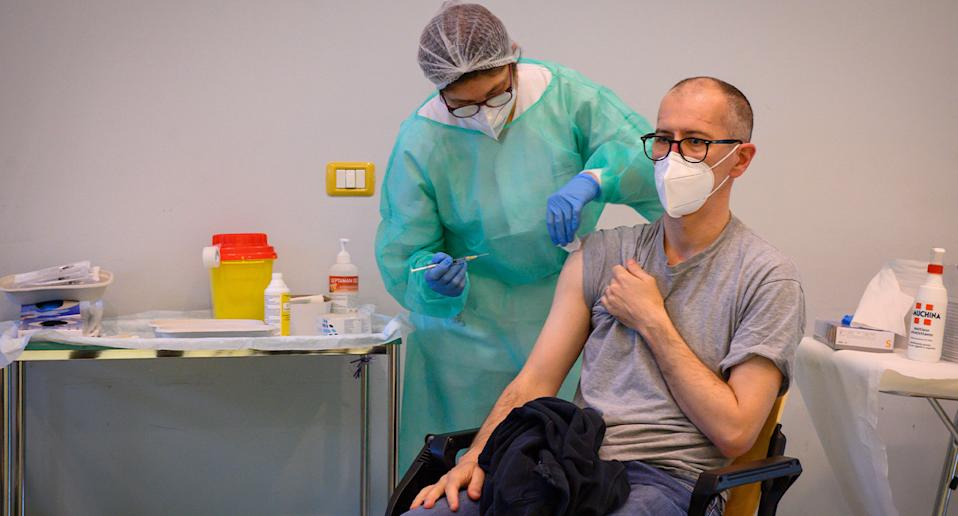 A man received the Covid-19 vaccine.