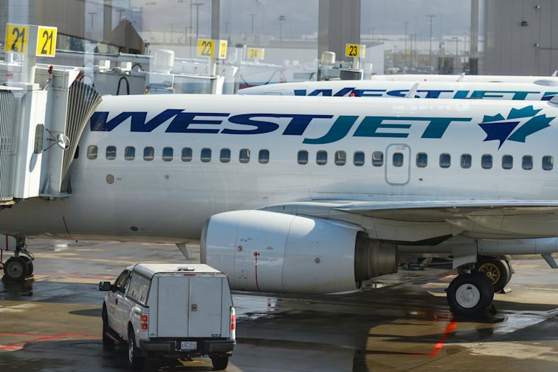 A view of WestJet planes at Calgary International Airport. On Monday, September 10th, 2018, in Calgary, Alberta, Canada. (Photo by Artur Widak/NurPhoto via Getty Images)