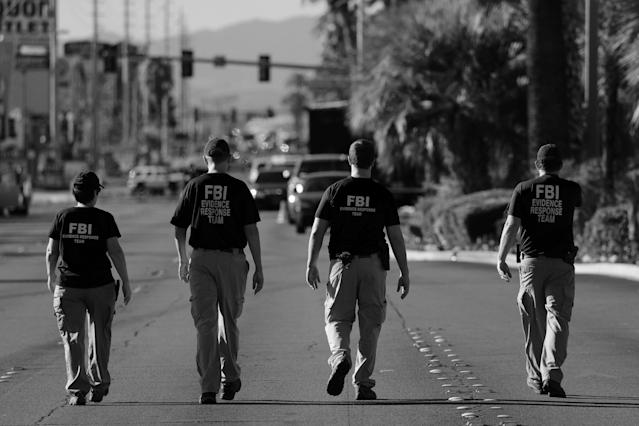 An FBI evidence response team on Oct. 3 looks over the crime scene following the mass shooting at the Route 91 Harvest Country Music Festival on the Las Vegas Strip. (Digitally enhanced photo: Mike Blake/Reuters)